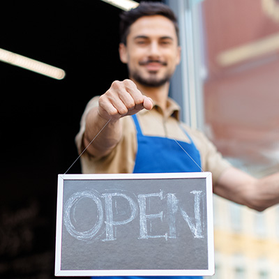 bigstock-Small-Business-Owner-With-Open-200598727